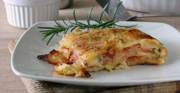 Zapékané brambory se čtyřmi druhy sýrů a mortadellou